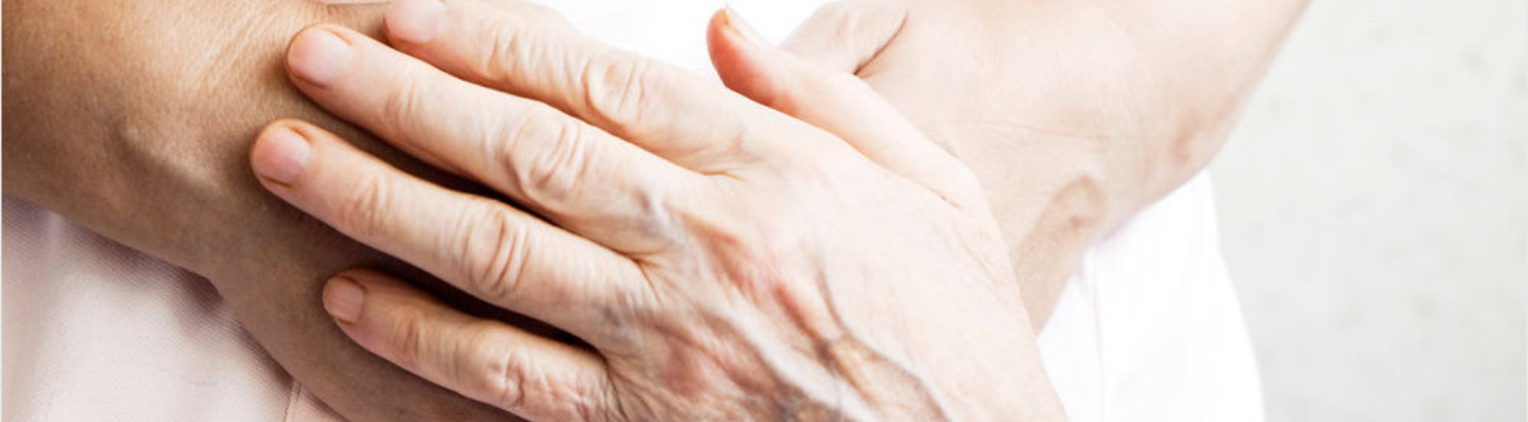 Dignity at the end of life - Youg and old holding hands